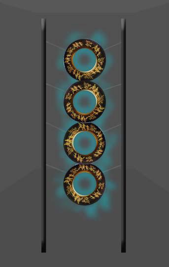 Betsabeé Romero, Huellas y cicatricez (Traces and scars) (representación), 2018; cuatro llantas con grabados, pan de oro y soporte de acero, aprox. 192 1/2 x 86 5/8 x 9 3/4 pulgadas. Cortesía del Taller de Arte de Betsabeé Romero.